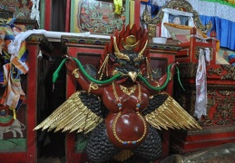 The Garuda (Tibetan: Khyung), biding down on a snake, will be mounted behind the head of the Buddha statue.