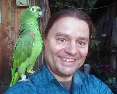 Daniel with Don Jorge's friendly parrot in Pauna